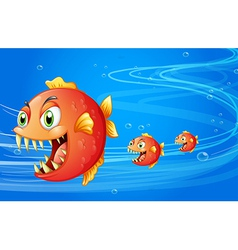 Three fishes under the water vector image