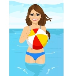 woman holding an inflatable striped ball vector image vector image