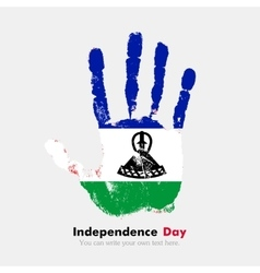 Handprint with the flag of lesotho in grunge style vector