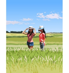 Two modern women in a green field vector