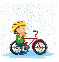 Boy riding bike in rain vector