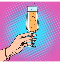Toast a female hand with glass of champagne vector