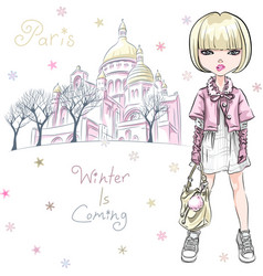 Fashion girl in winter clothes in paris vector