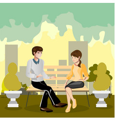 a loving couple sitting on a park bench vector image