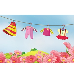 A garden with hanging clothes for the baby vector