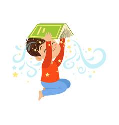 cartoon little boy holding open magic book over vector image