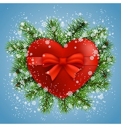 Heart in fir branches and snow vector image
