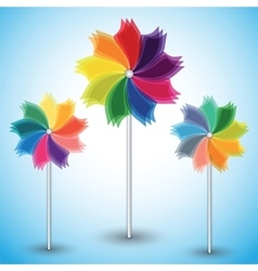 Three colorful windmills on blue background vector image