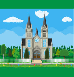 Catholic church cathedral with trees and fence vector