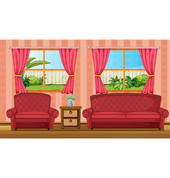A red sofaset and side table vector image