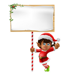 christmas elf holding a sign vector image vector image