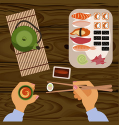 person is eating delicious sushi vector image vector image