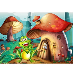 A frog near the mushroom house vector