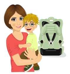Young mother holding little boy near baby car seat vector