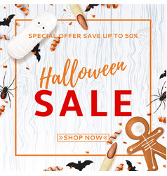 Halloween sale background with treats vector