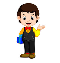happy and well dressed boy holding a gift box vector image vector image