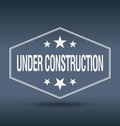 Under construction hexagonal white vintage retro vector