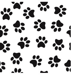 Black animal paw prints seamless pattern vector