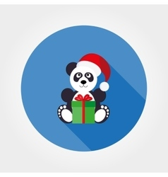Panda in a santa hat with a gift vector