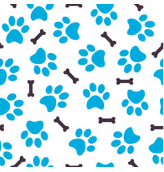 Seamless pattern of blue animal paws with bones vector