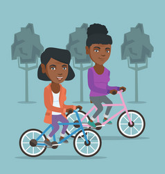 Retired african women riding bicycles in park vector