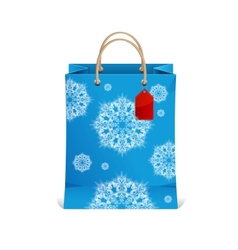 Christmas shopping bag with snowflakes vector