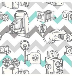Hand-drawn doodle set of retro cameras vector