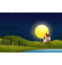 A castle at the hill under a bright moon vector image vector image