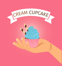 hand holding blue cream cupcake vector image
