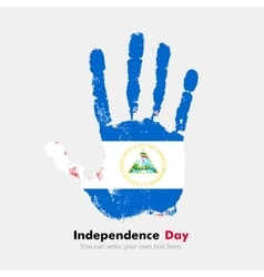 Handprint with the flag of nicaragua in grunge vector