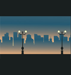 Street lamp with city scenery silhouettes vector