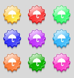 Umbrella icon sign symbol on nine wavy colourful vector