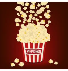Popcorn falling in the striped popcorn bag vector