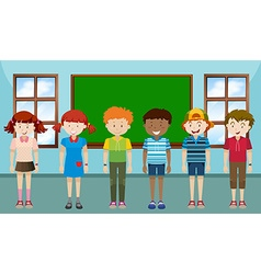 Children standing in classroom vector