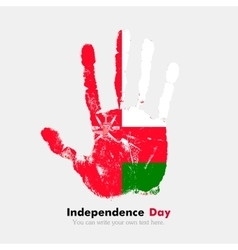 Handprint with the flag of oman in grunge style vector