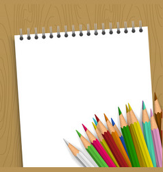 empty notebook with color pencils vector image vector image
