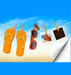Flip flops sunglasses and photo cards hanging on vector