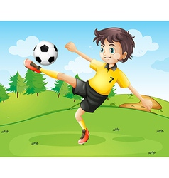 A female football player in her yellow uniform vector