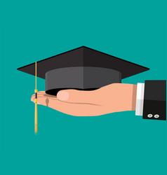 Academic graduation cap in hand student hat vector