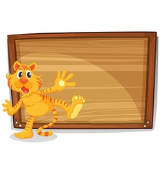 A tiger in front of a blank board vector