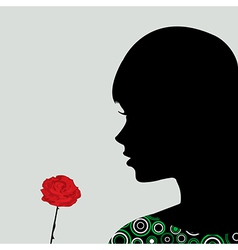 Girl smelling a rose vector image vector image