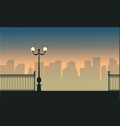 Silhouette of town and street lamp landscape vector