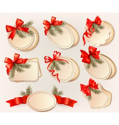 Set of christmas gift cards with red gift bows vector