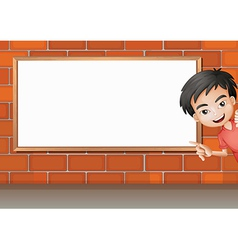A smiling boy and a white board vector image vector image