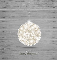 Christmas ball with snowflakes on wood background vector image