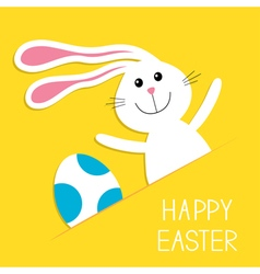 Happy easter bunny rabbit hareand blue painted egg vector