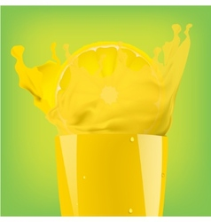 Falling piece of lemon in a glass of juice vector image