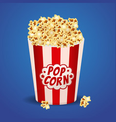 popcorn in a red striped bucket box vector image vector image