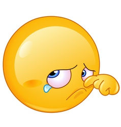 Wiping tear emoticon vector