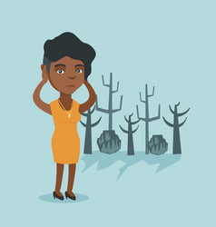 Young african woman standing in a dead forest vector